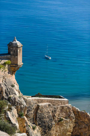 Sea view with a yacht from the castle of Alicante. Редакционное