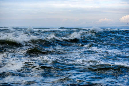 A rough ocean, rough waves on the ocean off the coast of France.