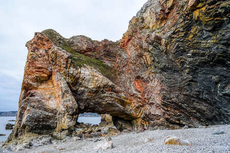 Rock formations, colorful rocks, geological formations off the coast of France.