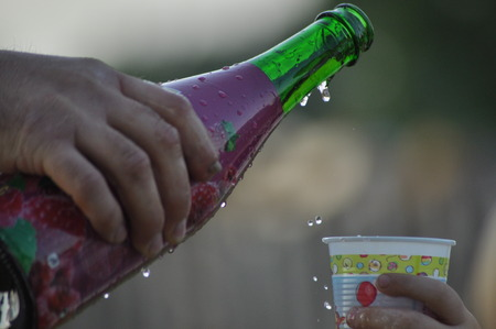 renunciation: Champagne to celebrate a birthday. The drink poured into the cup
