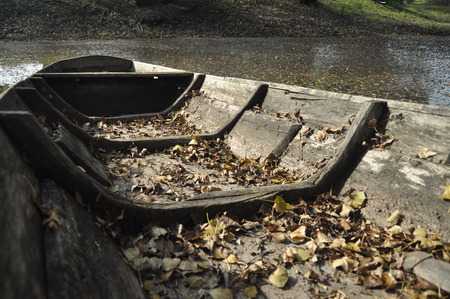 wooden boat: Wooden boat moored on the shore. An autumn day Stock Photo