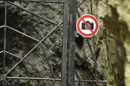 paternal: The ban on photographing the object. A sign at the entrance gate metal. The caves in the national park. Paternal National Park.