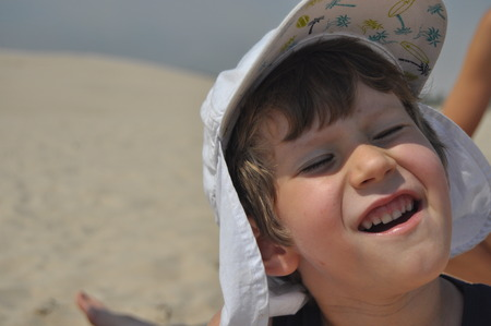 sunstroke: The boy on the dunes. Sand in the Slowinski National Park, Tourism Stock Photo