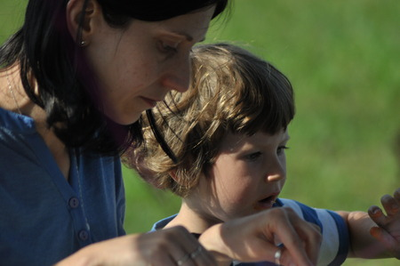 A child with a mother. The boy and woman eating a meal Stock Photo