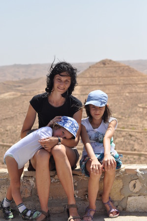 antics: Family for a walk in Tunisia. Mother and children. Walk and Fun Stock Photo