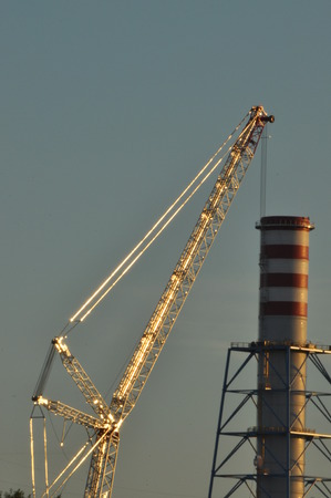 industrialization: Power plant. Crane at a construction site. Chimney and smoke