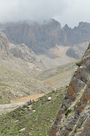 steep cliffs: Taurus Mountains. Turkey. Steep cliffs and gorge. Snow-capped peaks.