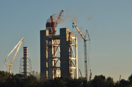 toxicity: Power plant. Crane at a construction site. Chimney and smoke