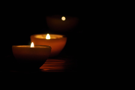 challis: Lamp, candle shining in the darkness. Challis flame. Artistic composition. Lighting.
