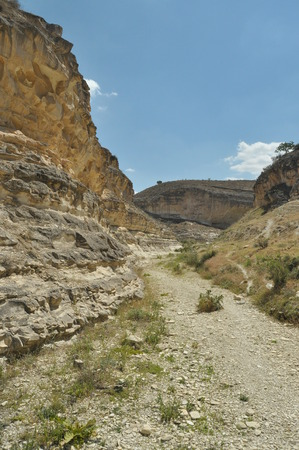 twisty: Gorge with steep walls. South East Turkey. Leisure and tourism. Climbing the mountain