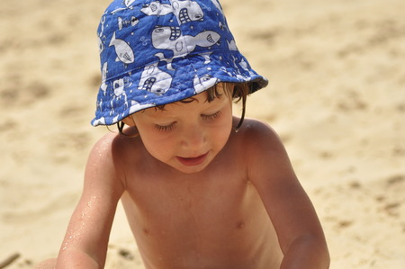 sand mold: Boy sticky sand castles. The sea and beach in an exotic country. Tourism.