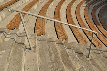 rungs: Amphitheater. Wooden benches set in stone circle.