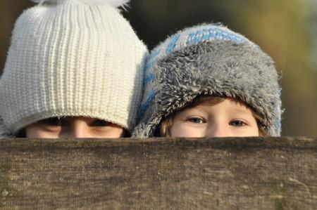 'hide out': Boy, girl. Joyful siblings. Fun. Stock Photo