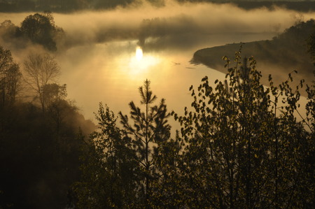 Sunrise. The river in the mist. A view of the meadows and the river in the morning.
