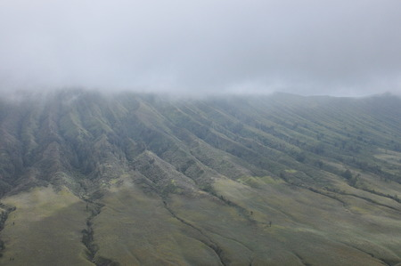 cone shell: Climbing the volcano Bromo, Indonesia. Clouds obscured the crater and green valley