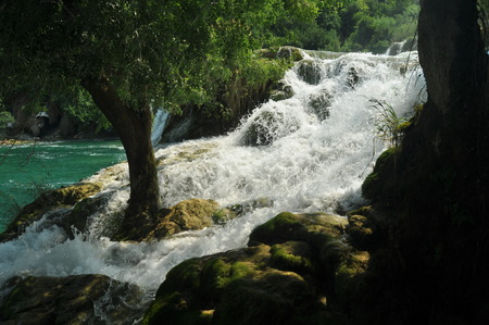 Waterfalls in Krka National Park in Croatia. Strength and picturesque miracle of nature