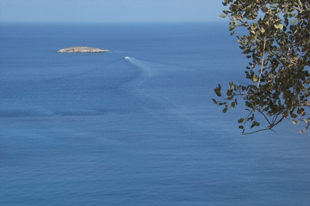 warm climate: Mediterranean sea, Akamas National Park. The view from the rocks on the island and boat. Stock Photo