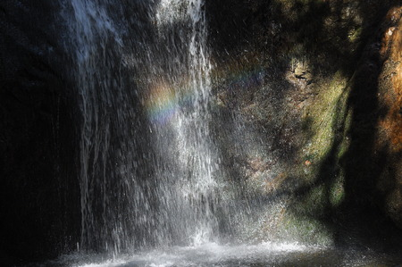 impassive: Rainbow at the waterfall Millomeris, in the mountains in Cyprus