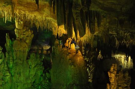 Prometheus Cave. Georgia. Stalactites and stalagmites highlighted colors. Stock Photo