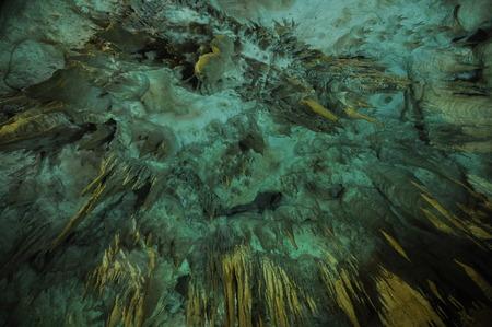 stalagmites: Prometheus Cave. Georgia. Stalactites and stalagmites highlighted colors. Stock Photo