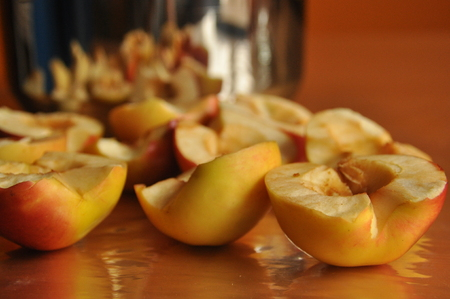 Sliced apples compote. Pot for preparing a beverage. Stock Photo