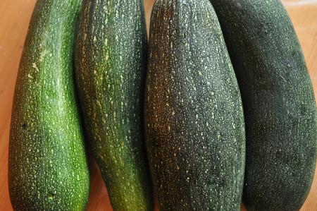 Courgette. Preparing vegetable dishes in a mortar. Stock Photo