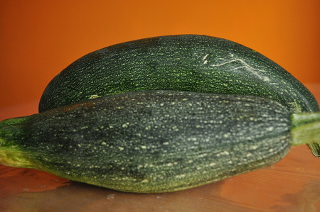 identical: Courgette. Preparing vegetable dishes in a mortar. Stock Photo