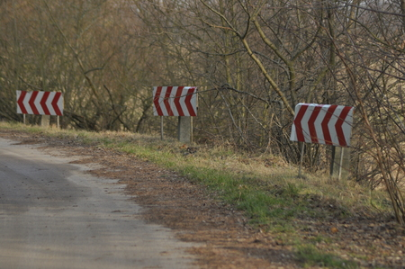 Road signs, the sign of the bend. Winding road.
