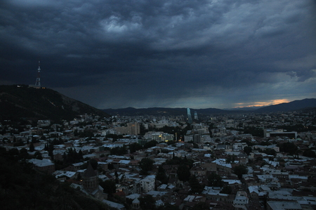 Tbilisi. View of the city and a monument to the mother of Georgia from the hill during the storm. Stock Photo