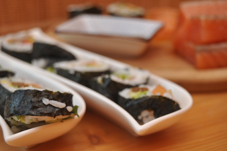 specific: Sushi. Delicious meal with fish, rice and supplements, prepared at home.