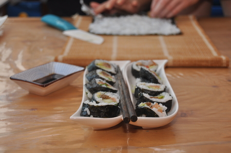 Sushi. Delicious meal with fish, rice and supplements, prepared at home.