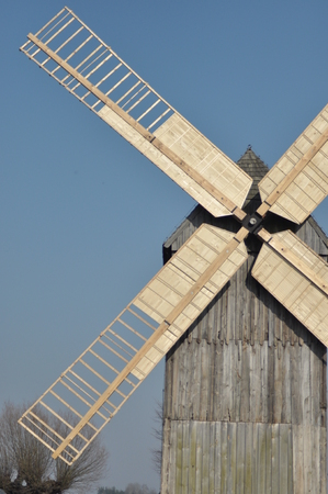 Wooden windmill. Monument. Antique mill powered by the wind 스톡 콘텐츠