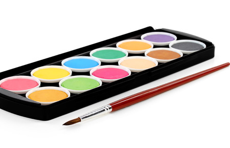 paints of different colors and slim paintbrush (brush) photo