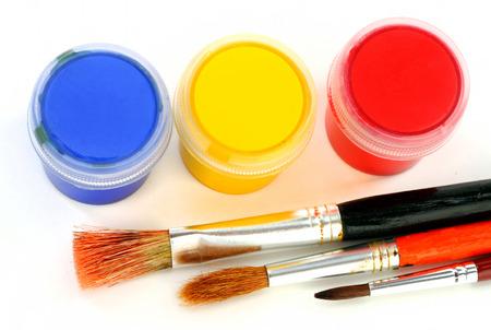 multicolor children paints brushes photo