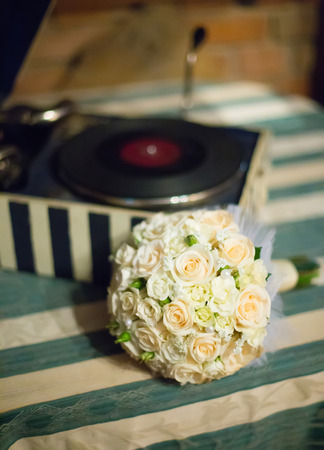 saturate: wedding saturate white rose bouquet of bride on table Stock Photo