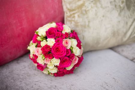 saturate: wedding saturate pink rose bouquet of bride on sofa