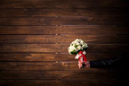 registrar: wedding bouquet of white roses in groom Stock Photo