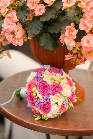 saturate: wedding saturate pink rose bouquet of bride on table Stock Photo