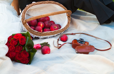 red wedding bouquet and apples photo