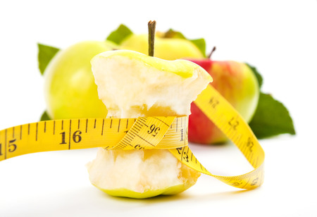 apple core: apple core and measuring tape. Diet concept