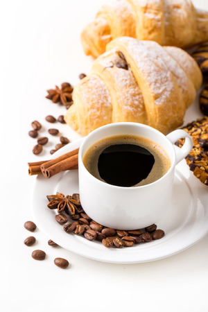 Breakfast with coffee and croissants on table Standard-Bild