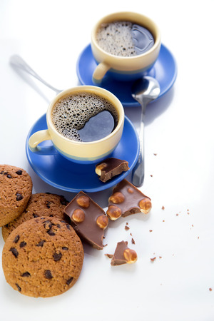 hot coffee, chocolate and cookies in morning Standard-Bild