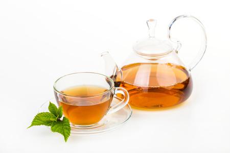 Tea composition with mint leaf on white Standard-Bild