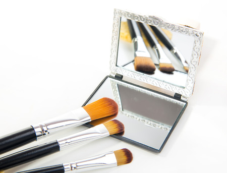 different professional cosmetic brushes on white