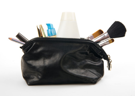 various cosmetics in bag isolated on white background photo