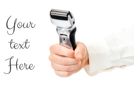 electric shaver: Male electric shaver in hands fist Stock Photo