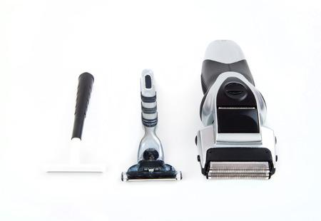 Electric and basic razors on white  photo