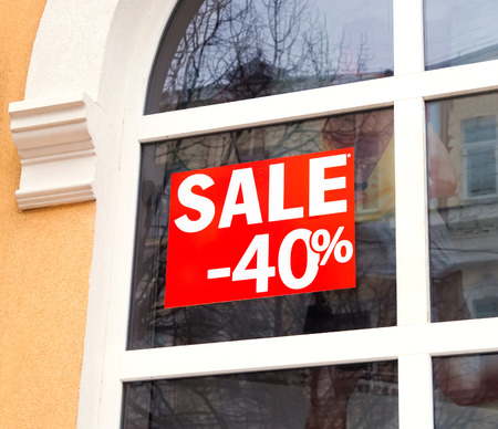 Discount sale sign in the window