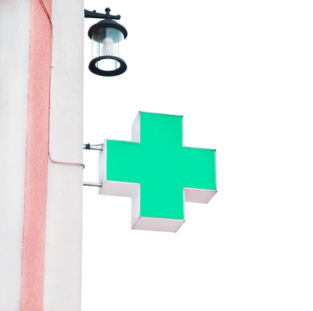 green cross: Green cross indicating the location of a pharmacy