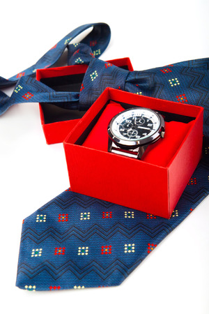 classic business watches in red box and abstract blue necktie isolated on white